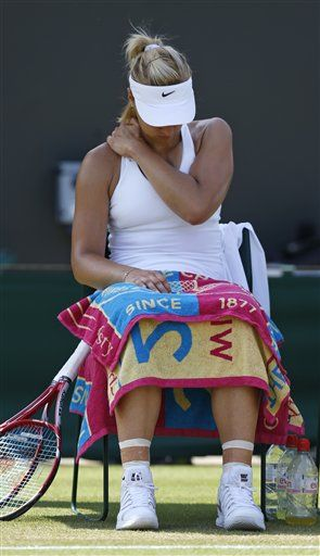Sabine Lisicki of Germany holds her shoulder during the women's singles match against Yaroslava Shvedova of Kazakhstan at the All England Lawn Tennis Championships in Wimbledon, London, Tuesday, July 1, 2014. (AP Photo/Sang Tan) ▼1Jul2014AP 5 things at Wimbledon: Federer's perfect serving http://bigstory.ap.org/article/5-things-wimbledon-federers-perfect-serving #The_Championships_Wimbledon_2014 #Sabine_Lisicki