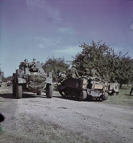 Canadian Humber Mk IV & Bren Gun Carrier on the move in France.