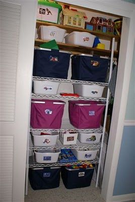 Toy library hall closet or white cabinet organisation Closet toy storage ideas