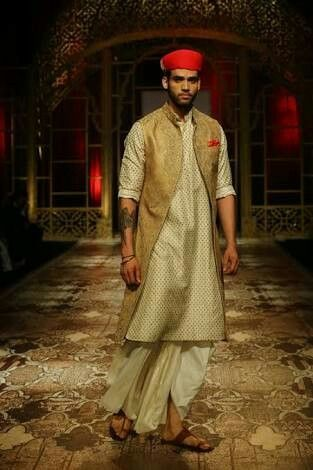 Reincarnating Relics by Raghavendra Rathore. Gold beige kurta paired with silk dhoti and golden jacket