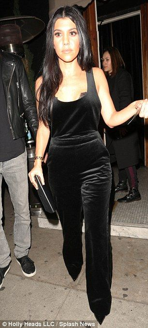 Bra-ving the cold: Kourtney flashed a glimpse of her sexy lace bra which