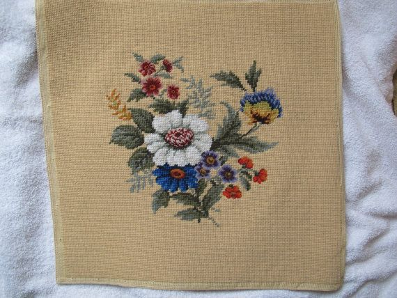 Stunning detailed wool needlepoint petit point floral panel. The pictures do not do this piece justice! Would look gorgeous framed or would likely be the perfect size to recover that special chair. A white, purple, blue and orange bouquet of flowers on pale gold/tan background. Finished