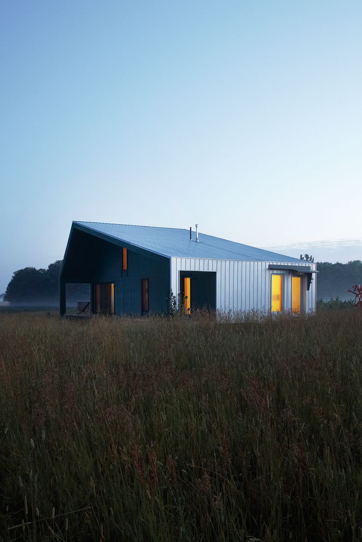 The 925-square-foot house Maggie Treanor calls home blends into the landscape somewhat; with a galvanized steel shed roof and siding, it looks like a high-design little brother to the barns on the surrounding farms.