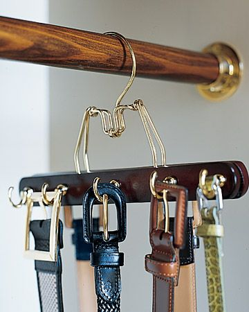 Portable Hooks  To create a belt rack that matches your other hangers (and doesn't require making holes in the wall), try this: Predrill a row of holes in alternating spots on both sides of a wooden clamp hanger, and screw in cup hooks. Make as many of these hangers as you need to accommodate your belts.