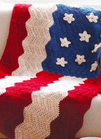 Add some patriotic touches to your home with this soft and cuddly American flag blanket.