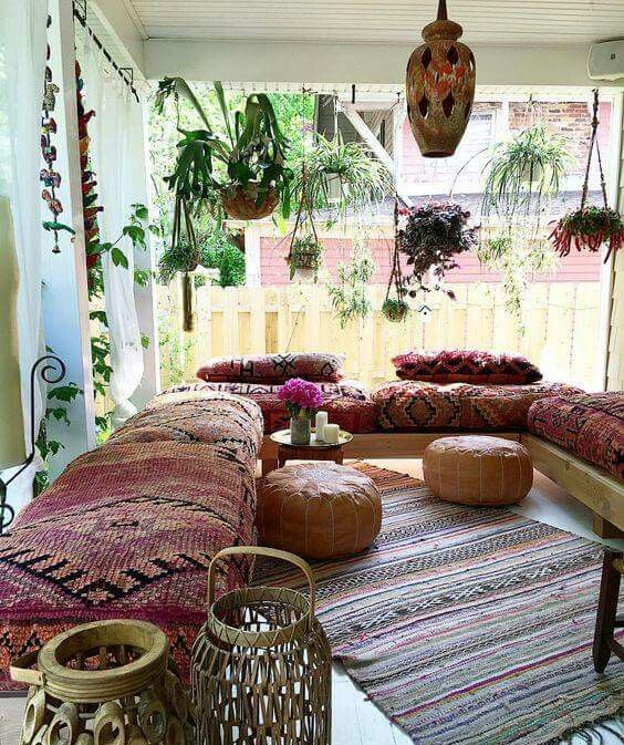 Hanging Plants And Seating In Sunroom