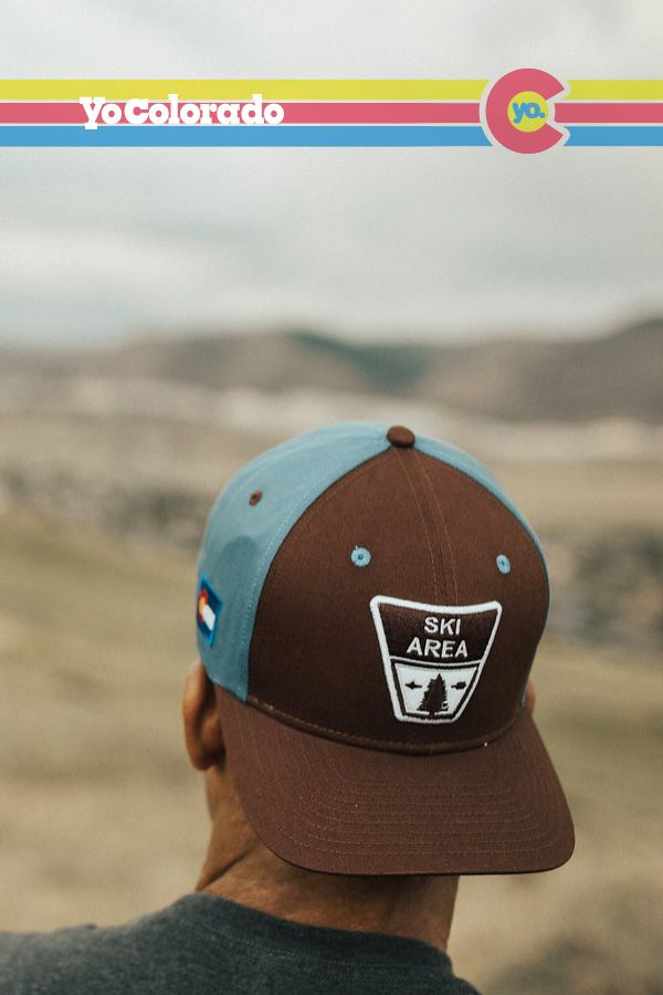 c3597c03895f5 We took our popular Ski Area Trucker Hat and changed the tan mesh to a  slate blue cotton twill material. This special edition hat will keep your  head a ...