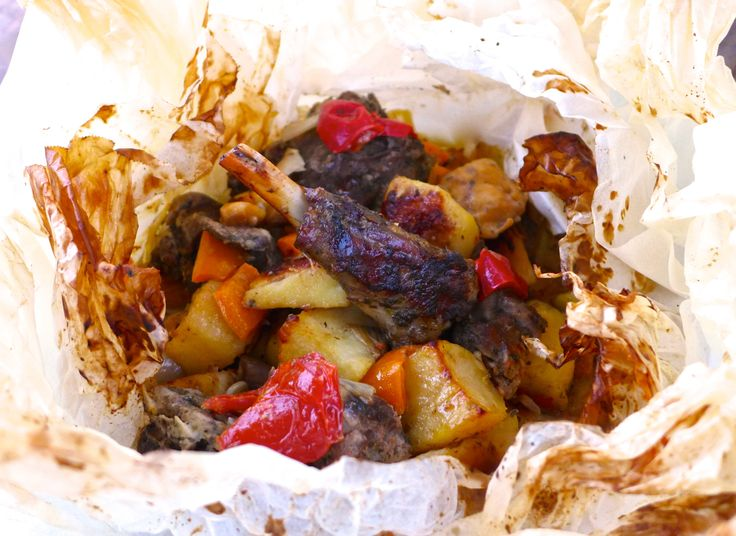 Greek Lamb Kleftiko recipe. I swap the onions for echalion/banana shallots and use shoulder instead of leg. I cook in the slow cooker then brown in the oven.
