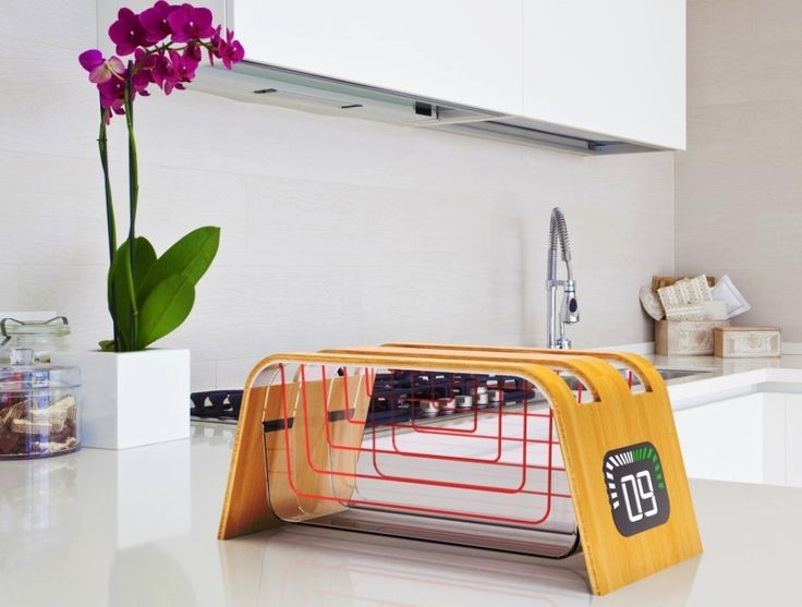 Fed up eating burnt toasts by tedious pop-up toasters? This happens because you're never able to see what's going inside that tiny toasting machine. But the all-new Bamboo and Glass Toaster by StumpfStudio is designed to let you see how your bread is being toasted inside the transparen