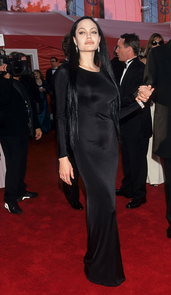 Angelina's hair is extremely long and matches her black gown for the 72nd Annual Academy Awards, certainly a striking look.