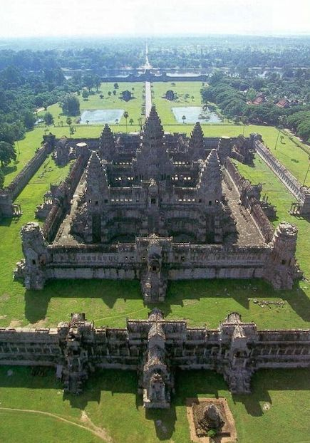Angkor Wat (Temple City), constructed at the peak of the Khmer Empire circa 1115-1150 A.D. Nearby Angkor Thom (Large City) followed about a half-century later, from 1185-1210 A.D.