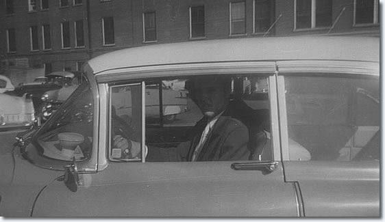 Elvis Presley is leaving in his famous 1955 pink cadillac after visiting his mother at the hospital