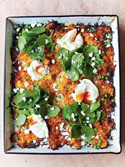 giant veg rosti with poached eggs, spinach and peas