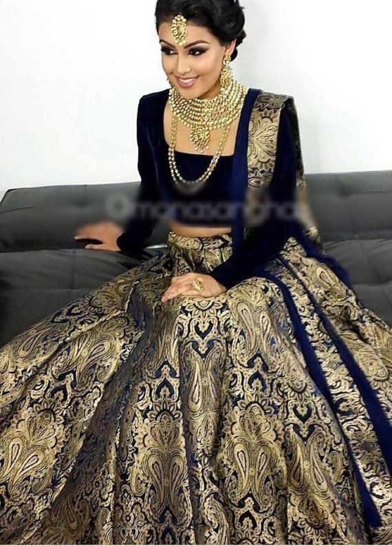 Navy blue brocade lehenga/anarkali this party wear Indian dress can be made into a lehenga or a gown (anarkali) and it has a navy dupatta. The outfit is a custom made garment which includes the blouse, skirt and the dupatta (stole). Blouse material is silk, skirt is in brocade and