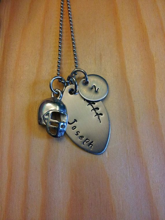 Handstamped football necklace.  https://www.etsy.com/listing/190065543/hand-stamped-necklace-personalized