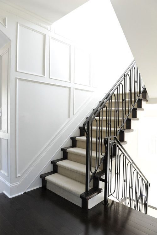 Trim out stairway. Ironwork.