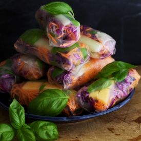 Rice paper rolls with melon, herbs, red cabbage, carrot and spicy almond pesto.