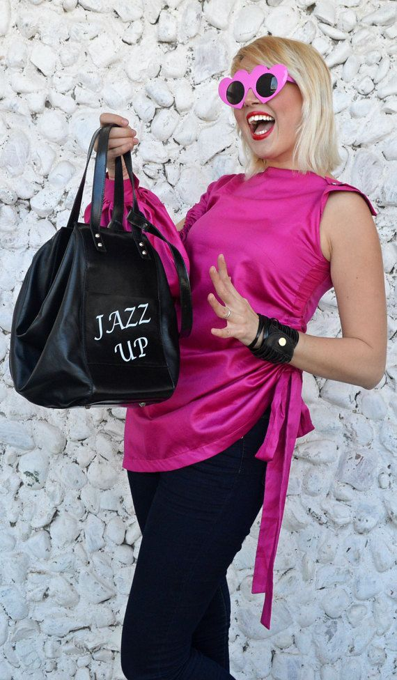 Black leather handbag, large, spacious and very practical. Personalized bag with our funky motto Jazz up!, enliven the streets and the urban scene. Comfortable travel bag, with adjustable strap. Material: 100% genuine leather  Dimensions: Height 31 cm / 12 inches Width 36 cm / 14 inches Depth 31 cm / 12 inches  The pink top in the photos: https://www.etsy.com/listing/508576621/extravagant-pink-top-asymmetrical-pink