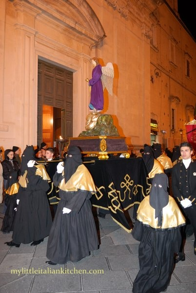 Holy Week's procession at Lanciano in Abruzzo~ hooded men, called Brothers, walk around the town in the dark wearing a black robe and holding a torch.It 's the night of the Last Supper..CLICK on photo the page explains more.. very interesting