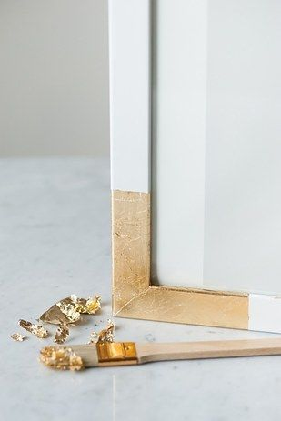 Apply gold leaf or metallic gold paint to the edges of boring frames to make photos pop.