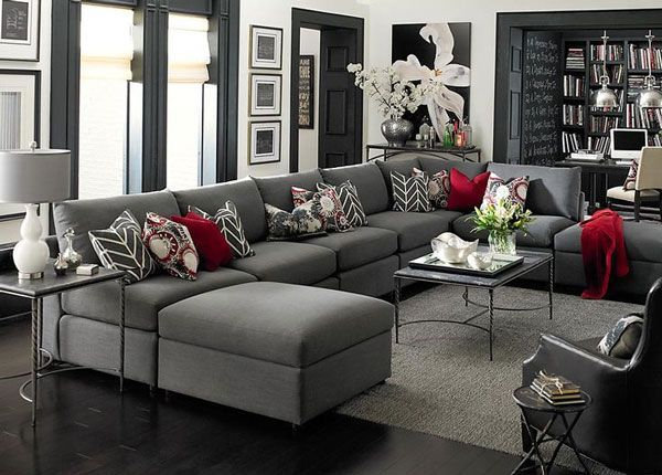 Maria suggests replacing the red pillows with white and layering a black and white zebra rug to keep this palette monochromatic