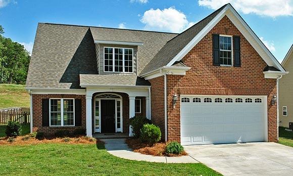 Black shutters, brick house, grey roof, white garage door, black front door, white sidelights