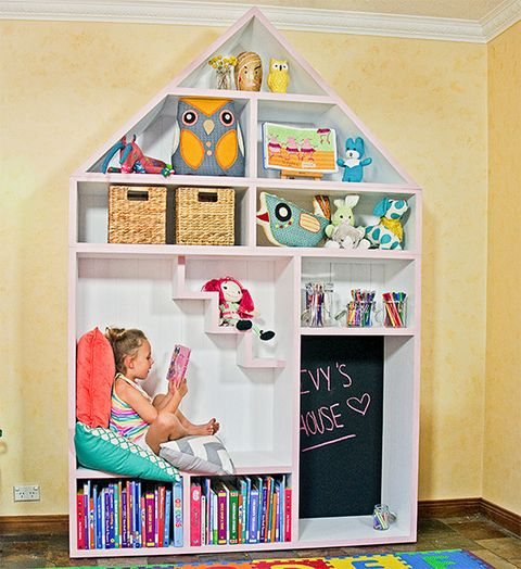 Want to inspire the kids to clean up by themselves, give them a game, and provide a fun space to hang out? This shelving and storage unit in the shape of a dollhouse is just the trick.