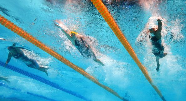 (L-R) Ueda Haruka of Japan, Bronte Campbell of Australia and Simone Manuel of USA compete during the Swimming Women's Freestyle 4x100m on day nine of the 15th FINA World Championships at Palau Sant Jordi on July 28, 2013 in Barcelona, Spain.