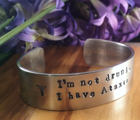 I'm not drunk, I have Ataxia,Hand Stamped Awareness Cuff with Medical Alert symbol,Hope ribbon,Need A Cure,Personalized Cuff,Engraving