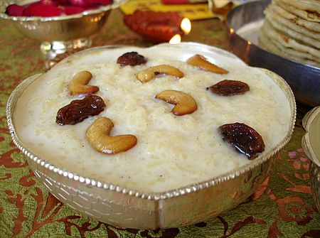 Annam Payasam aka Paramannam (Food of the Gods) is prepared with raw rice, milk and jaggery or sugar. Rice is slowly simmered in milk and cobined with jaggery, flavored with aromatic cardamom and garnished with toasted cashewnuts and raisins. - Gluten Free, contanis dairy & nuts.