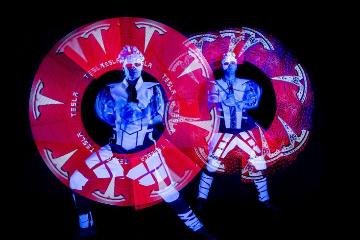 Visual Pixel Poi dancers with Tesla logo.  Visual Pixel Poi technology (also known as graphic juggling with LED poi) enables dancers and performers to display graphic elements during the performance that will become a part of the Fire or UV Light show.  http://antaagni.com/visual-pixel-show/