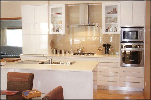 off white kitchen   Contemporary Polyurethane kitchen with Quantum Quartz bench tops.