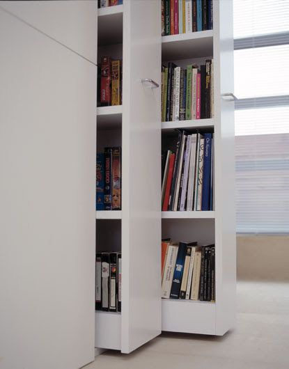 Retractable bookshelves inside Claudio Silvestrin's home. Essential to a minimalist interior is having enough storage space.