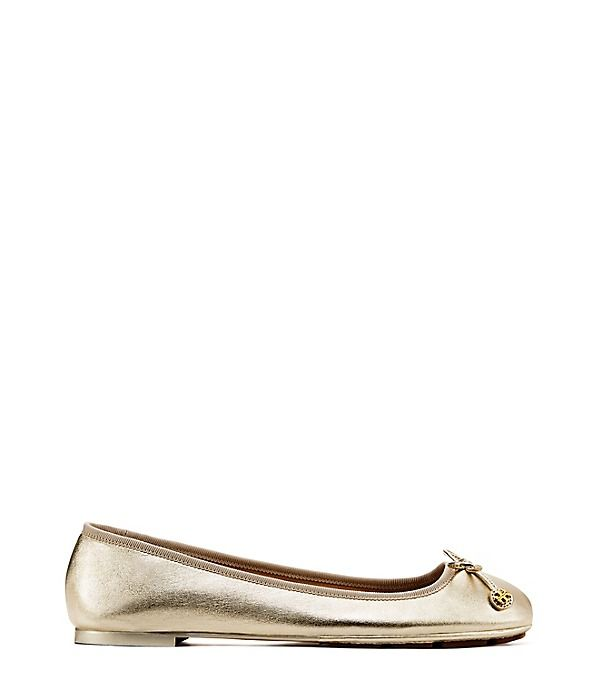 LAILA METALLIC DRIVER BALLET FLAT in spark gold - The Laila combines the classic lines of a ballet flat w the comfort & traction of a driving shoe. Made of lightly grained metallic leather, this versatile square-toe silhouette features a bow tie w/logo-accented disks & rubber pods on the front of the sole — a detail that adds superior cushioning, flexibility & grip. Lightly grained metallic leather upper Fabric tie w/metal double-T logo lace tips Napa leather lining Rubber pods at front of…