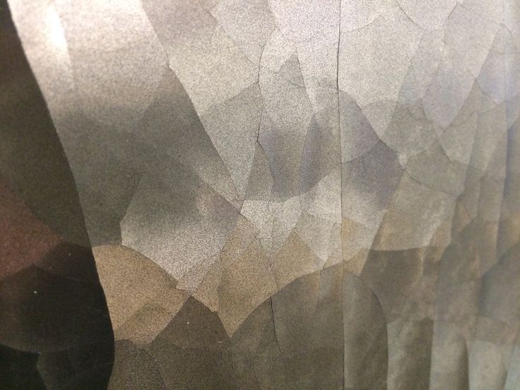 CRACKED METAL AGED-BRONZE  Flexible veneer finish suitable for applying to walls or furniture.  Handmade in England by Stuart Fox Ltd info@stuartfox.co.uk