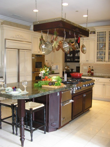 Island Stove Kitchen With Hanging Pots And Pans
