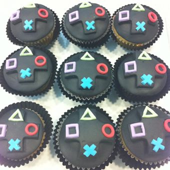 Playstation cupcakes Matt has a birthday coming up and I'm a little tired of making guitar cakes!, BTW, check out http://cheating-games.imobileappsys.com/