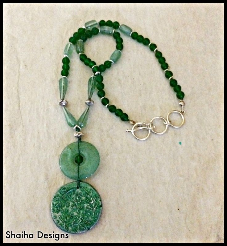 Dreaming+of+the+sent+of+pine?++Wandering+through+an+ancient+forest+that+has+never+known+the+touch+of+man.  This+lovely+necklace+features+a+carefully+aged+artisan+polymer+focal,+jade+doughnut,+vintage+glass,+and+cultured+sea+glass.++The+lead+free+pewter+clasp+is+adjustable+and+the+length+varies+...