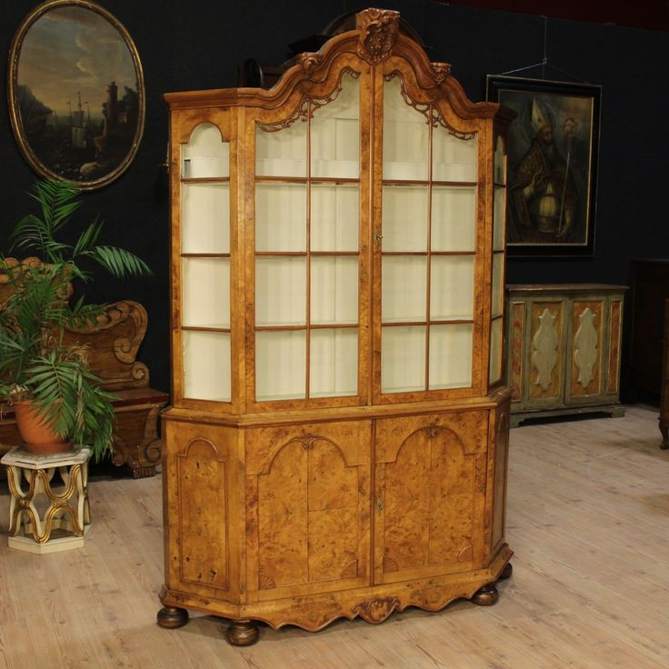 Price: 3300€ Dutch bookcase of the late 19th century. Furniture, carved in walnut and burl elm. Vitrine built as a sideboard in the lower part and as a showcase with two doors in the upper part. Furniture complete with two functioning keys. Painted inside of the upper part with three original shelves. It presents on the left a broken glass. In the complex in good condition. #antiques #antiquariato Visit our website www.parino.it