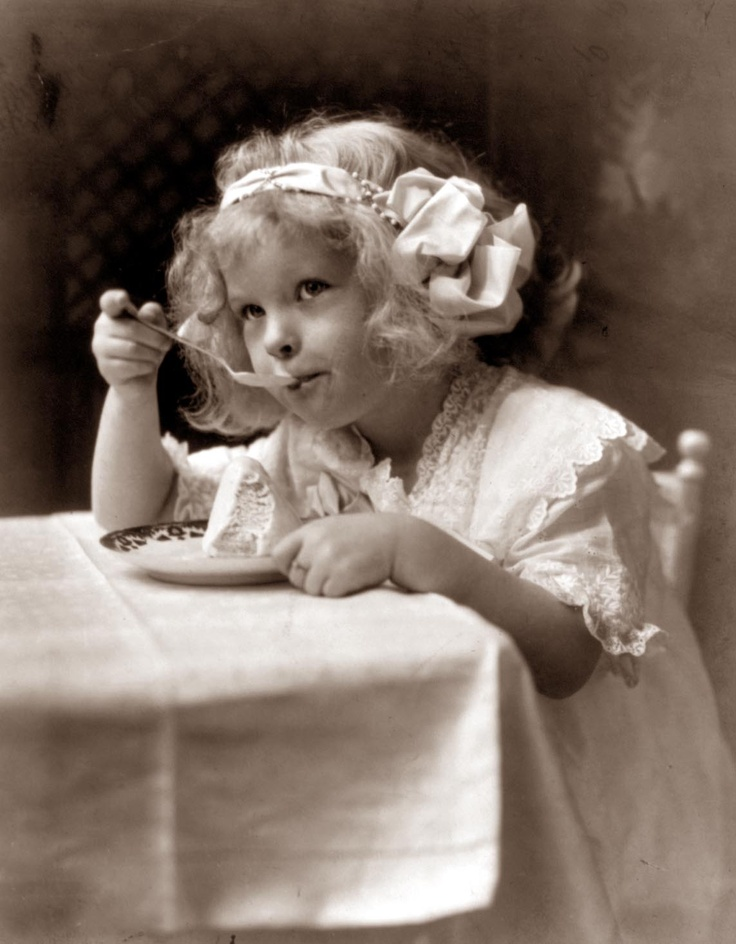 Old Picture of the Day: A vintage photograph of a little girl enjoying ice cream, taken in 1913. #photography