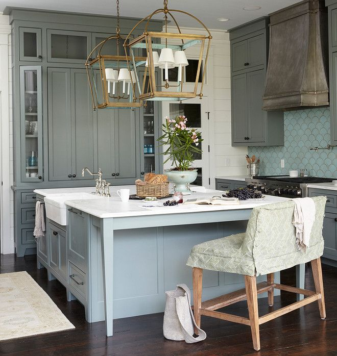 "Cabinet and kitchen island paint color are Sherwin Williams ""SW 6207 Retreat."" Urban Grace Interiors."