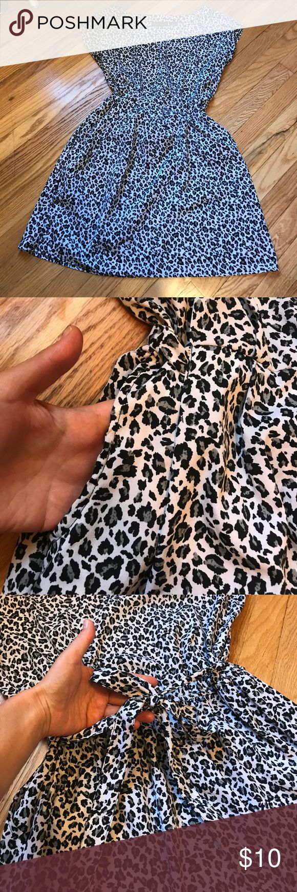 Animal print mini dress with a tie and two pockets Elastic at the back plus a tie to regulate the waist size. Two pockets on both sides. Very light dress. 18.5 inches from waist to bottom of the dress. Dresses Mini