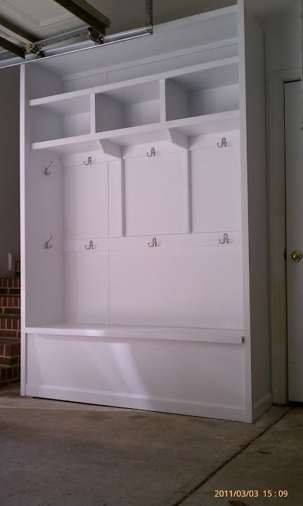 Garage storage cubbies with hinged bench and hooks all for Garage mudroom