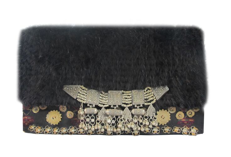 Clutch with Mink, Antique Afghani Fabric and Antique Yemeni Silver Embellishment. We Deliver Worldwide. Order now by writing to us on Facebook or e-mailing mailto:sales@anna.... For further information about our products, studio and upcoming trunk shows please feel free to contact us.