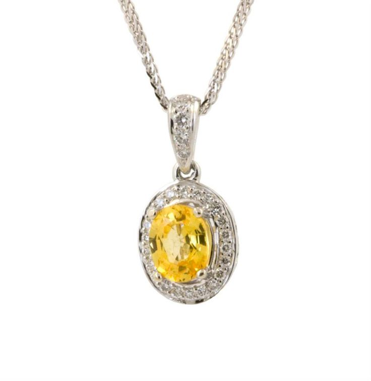 For a more classic look, try this gorgeous 18k white gold pendant with a 1.02ct oval cut yellow sapphire. The sapphire is surrounded in a halo by 26 diamonds for a total carat weight of 0.18cts. Place this jewel around her neck for her birthday and she'll be singing your praises! Nothing says elegance like a sapphire! www.gembycarati.com www.facebook.com/gembycarati