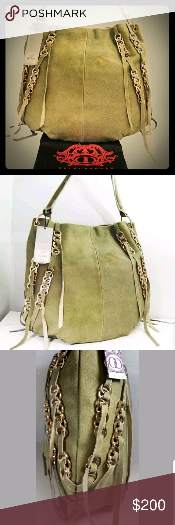 """KELSI DAGGER CAMERON Sage Suede Hobo Shoulder Bag KELSI DAGGER CAMERON Sage Suede Hobo Shoulder Bag  100%Authentic KELSI DAGGER CAMERON Sage Suede Hobo Shoulder Bag  MSRP$288.00 + TAX  BRAND:KELSI DAGGER  COLOR:SAGE  DIMENSIONS:16"""" L x 14"""" H x 3"""" W  SINGLESHOULDERSTRAP:7 DROP  EXTERIOR:  GENUINE SAGE SUEDE  SNAP TOP CLOSURE  GOLD TONE HARDWARE  RING STYLE STRAPS  GOLD-TONE INTERLOCKING CIRCLE HARDWARE WITH FREE-FLOWING FRINGE  This Bag was on display and was also handled by…"""