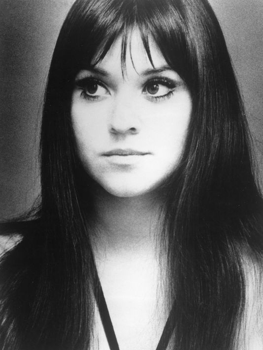 melanie safka. Whispy fringe, worn center parted with long dark hair. Oval to round face shape, medium size forehead with high crown of head. Very 60s look.