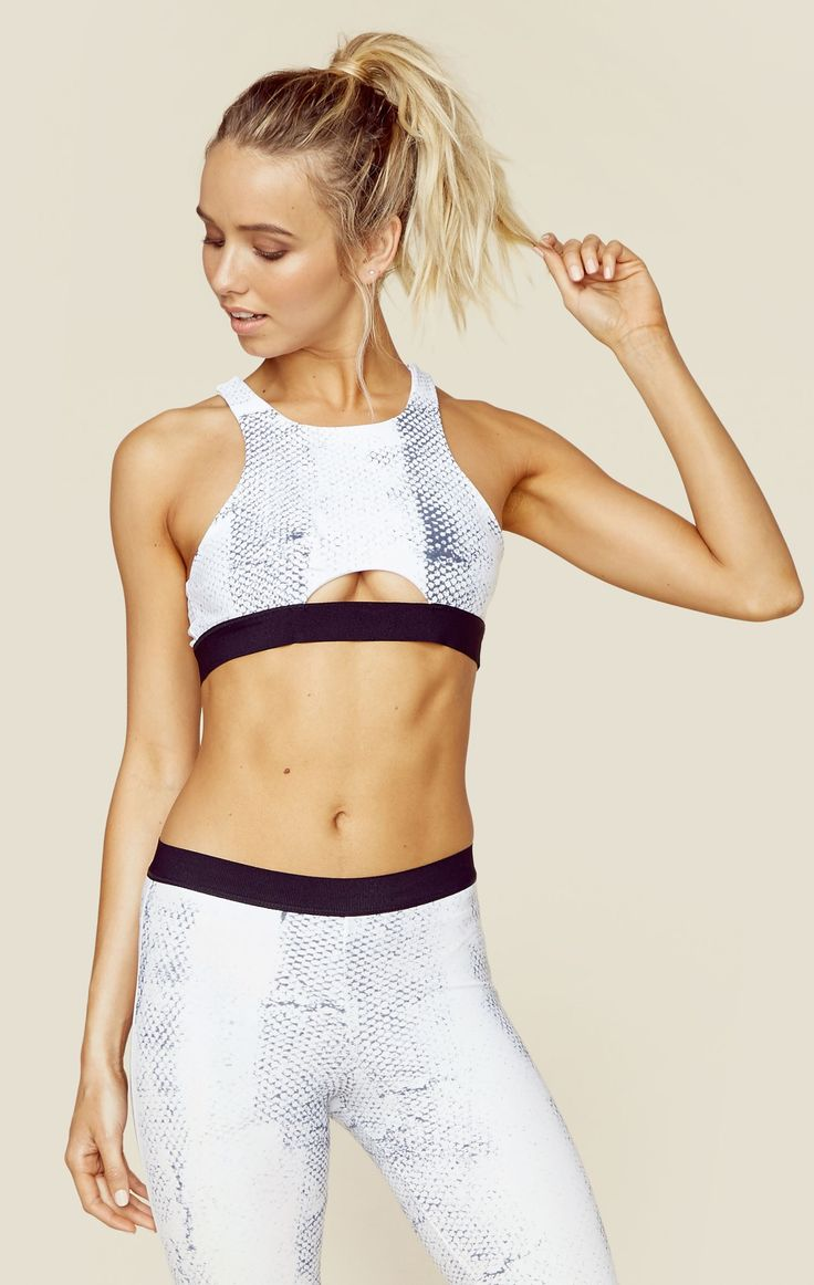 The Tie Dye High Neck Sportsbra features a a white snake print throughout, high neck silhouette, small cutout in the front, multi strap detailing in the back, and a thick elastic band for maximum supp