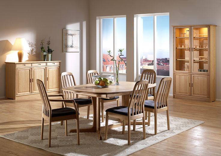 TITLE: Dining Room Furniture | Dining Table  The light high back dining chair 1588 with the back friendly bars offers good support along with the very comfortable seat. It also fits perfectly with our 9244 dining tables. In addition, if you like, some of  our cabinets or wall units can be used as a room divider. The photo shows: •	1588 high back chair w/Comfort 0049 •	1588A high back armchair w/Comfort 0049 •	9244B/1 dining table •	1155M sideboard •	1182M china cabinet