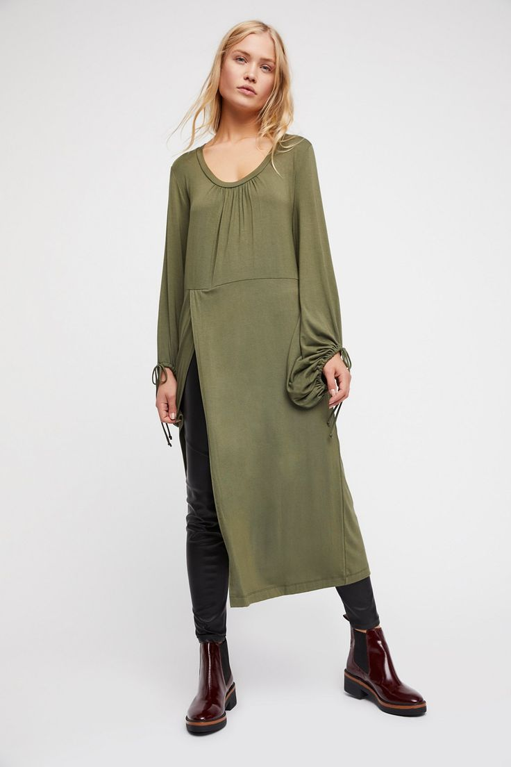 Constellation Tunic | Easy, comfy tunic top featuring a dramatic slit detail and drawstring accents at the sleeve cuffs for a cute, femme touch.    * Stretchy fabrication   * Scoop neck